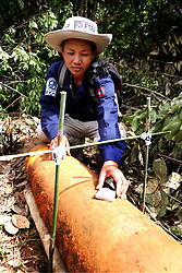 Vanny Soutthasy (Team leader) for FSD preparing a low-order detonation of a USA made 500lb that had been dropped but failed to detonate, at Taoun Village, Laman District, near Sekong, Lao PDR