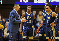 Dec 8, 2018; Morgantown, WV, USA; Pittsburgh Panthers head coach Jeff Capel talks with his team during the first half against the West Virginia Mountaineers at WVU Coliseum. Mandatory Credit: Ben Queen-USA TODAY Sports