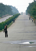 NORTH KOREA:<br /> The pictures Kim Jong Un doesn't want you to see<br /> <br /> Since 2008, Eric Lafforgue ventured to North Korea six times. Thanks to digital memory cards, I was able to save photos that I was forbidden to take or was told to delete by the minders.<br /> <br /> Photo Shows:   Public transportation connecting the main towns is nearly nonexistent. Citizens need permits to go from one place to another. On the highways, you can spot soldiers hitchhiking.<br /> ©Eric Lafforgue/Exclusivepix Media