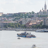 Rescue personnel work on transporting the passenger boat Hableany (means Mermaid in Hungarian) on another boat from the crash site for crime scene examination after it was lifted up from the river following it's capsize in an accident on river Danube in downtown Budapest, Hungary on June 11, 2019. ATTILA VOLGYI