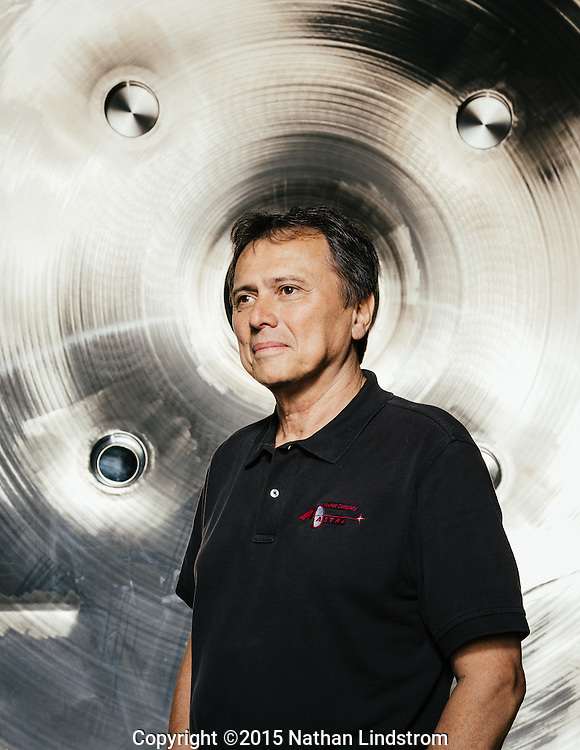 CEO of Ad Astra Rocket Company Dr. Franklin Chang-Diaz is photographed in front of Ad Astra's vacuum chamber Thursday afternoon March 19, 2015 where they test their Variable Specific Impulse Magnetoplasma Rocket (VASIMR®) technology.<br />