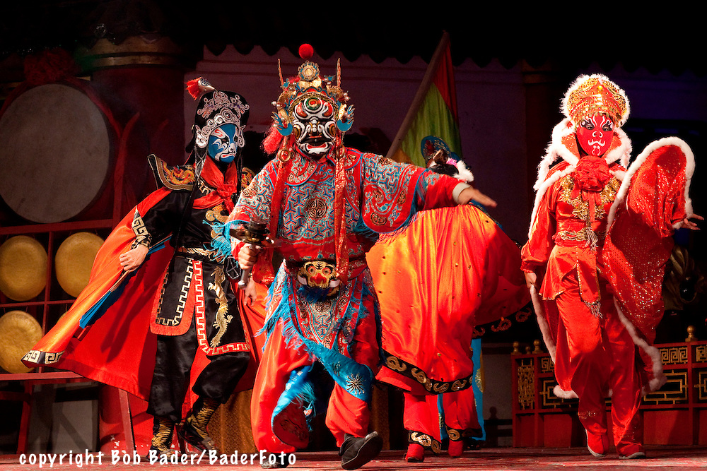 Masked actors performing in the Sichuan Opera in Chengdu, China
