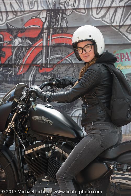 Iron Lilly Kristen Lassen on a 2014 Harley-Davidson Iron 883 Sportster at the Broken Spoke in Ormond Beach during Daytona Beach Bike Week. FL. USA. Tuesday, March 14, 2017. Photography ©2017 Michael Lichter.