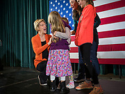04 NOVEMBER 2019 - GRINNELL, IOWA: US Senator ELIZABETH WARREN (D-MA), right, talks to a family on stage after speaking in Grinnell. Sen. Warren spoke to a crowd of about 850 students and local residents. She brought her campaign to be the Democratic nominee for the US Presidency to the college town of Grinnell, Iowa, Monday. Iowa holds the first selection event of the 2020 presidential election cycle. The Iowa caucuses are Feb. 3, 2020.           PHOTO BY JACK KURTZ