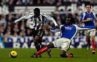 Photo: Jed Wee.<br /> Newcastle United v Portsmouth. The Barclays Premiership. 26/11/2006.<br /> <br /> Newcastle's Obafemi Martins (L) is tackled by Portsmouth's Linvoy Primus.