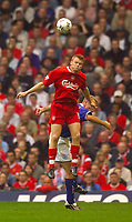 Photo. Jed Wee.<br /> Liverpool v Leicester City, FA Barclaycard Premiership, Anfield, Liverpool. 20/09/2003.<br /> Liverpool's John Arne Riise rises about Leicester's James Scowcroft to win the ball.