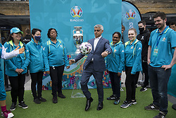 Mayor of London Sadiq Khan plays with a football alongside the Henri Delaunay Cup outside King's Cross Station, which made a special visit to London today as part of the UEFA EURO 2020 Trophy Tour. Issue date: Friday June 4, 2021.