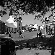 """06/06/1957<br /> 06 June 1957<br /> <br /> Views - Belleek, Co. Fermanagh<br /> <br /> <br /> Belleek (from Irish: Béal Leice meaning """"mouth of the flagstones"""") is a village in County Fermanagh, Northern Ireland. While the greater part of the village lies within County Fermanagh, part of it crosses the border into County Donegal, a part of Ulster that lies in the Republic of Ireland. This makes Belleek the western-most village in the United Kingdom. It had a population of 836 people in the 2001 Census, and is situated within the Fermanagh District Council area.<br /> Belleek is a thriving market town with a variety of pubs, shops, restaurants and a hotel. It is most famous for the fine parian china produced there at the Belleek Pottery, the oldest pottery in Ireland. The china is valued by collectors from all over the world. It is also a noted location for angling and other recreational activities and is now linked to the River Shannon by canal.<br /> The highest temperature in Northern Ireland recorded by the Met Office, 30.8°C, occurred at Knockarevan (near Belleek/Garrison) in County Fermanagh on June 30, 1976."""