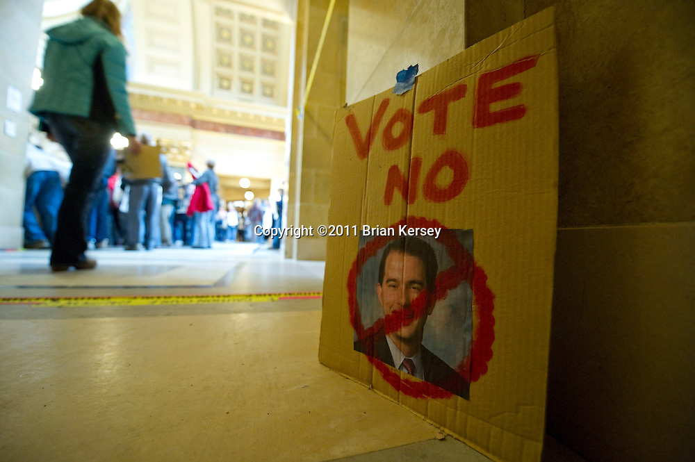 A sign left on the floor of the state Capitol expresses an opinion of Wisconsin Gov. Scott Walker in Madison, Wisconsin on February 25, 2011. Protests over budget legislation continued at the state Capitol for the 11th day.      (Photo by Brian Kersey)