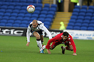 Joe Ledley of Wales is challeged by Alan Hutton of Scotland. Wales v Scotland, friendly international football match at the Cardiff City stadium, Cardiff, Wales, UK on Sat 14th Nov 2009.  pic by Andrew Orchard, Andrew Orchard sports photography