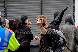 Anti-fascists gather to protest against a march held by the English Defence League. Walthamstow London May 2015