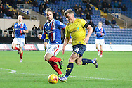 Oxford United midfielder Alex MacDonald about to shoot watched by Carlisle United defender David Atkinson during the Sky Bet League 2 match between Oxford United and Carlisle United at the Kassam Stadium, Oxford, England on 12 December 2015. Photo by Alan Franklin.