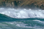 Prints up to A3 size only<br /> <br /> Massive Waves from the Irish Sea, rolling into the small cove of Porth Oer on the tip of the Llyn Peninsula in North Wales. I'd been surfing in these waves shortly before!