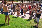 26 MARCH 2012 - PHOENIX, AZ: JENNA DUFFY talks to topless protesters in Phoenix. About 40 people marched through central Phoenix Sunday to call for a constitutional amendment to give women the same right to go shirtless in public that men have. The Phoenix demonstration was a part of a national Topless Day of Protest. Phoenix prohibits women from going topless in public so protesters, women and men, covered their nipples and areolas with tape. The men did it to show solidarity with the women marchers.    PHOTO BY JACK KURTZ