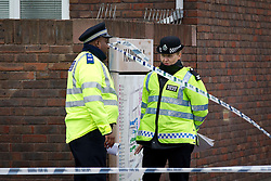© Licensed to London News Pictures. 19/09/2013. London, UK. Police officers are seen manning a cordon surrounding the site of a shooting on Coppock Close in Battersea London today (19/09/2013). Taking place at around 8pm last night a 19 year old male was pronounced dead at around 9pm. Photo credit: Matt Cetti-Roberts/LNP