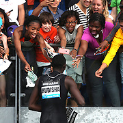 David Rudisha, Kenya, signs autographs for spectators after winning the adidas Men's 800m during the Diamond League Adidas Grand Prix at Icahn Stadium, Randall's Island, Manhattan, New York, USA. 14th June 2014. Photo Tim Clayton
