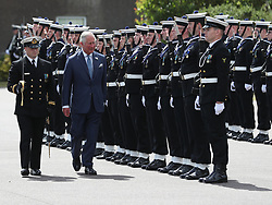 The Prince of Wales inspects a guard of honour<br /> during a visit to the Naval Base, near Cork as part of his tour of the Republic of Ireland.