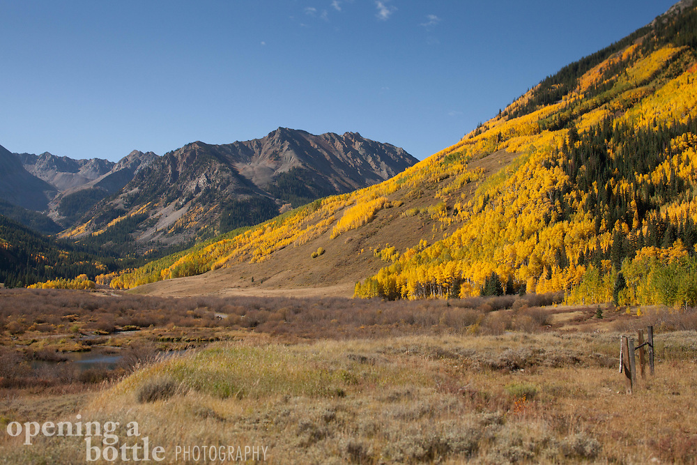 Looking into Maroon Bells-Snowmass Wilderness at the height of fall color from Castle Creek Road, south of Aspen, Colorado.