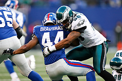 11 Jan 2009: Philadelphia Eagles linebacker Tank Daniels #50 stops New York Giants running back Ahmad Bradshaw #44 during the game against the New York Giants on January 11th, 2009.  The  Eagles won 23-11 at Giants Stadium in East Rutherford, New Jersey. (Photo by Brian Garfinkel)