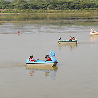 People relaxing by Sukhna Lake, near Chandigarh