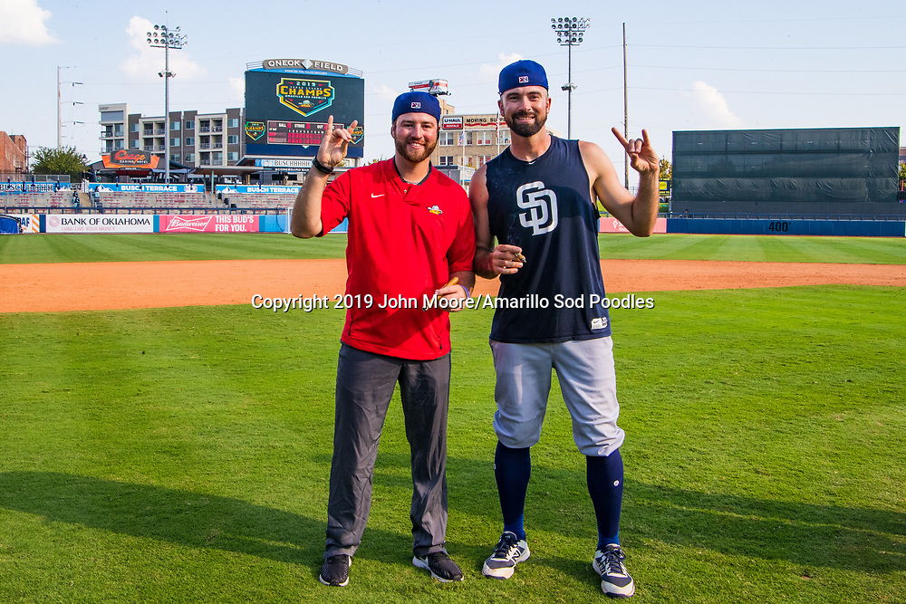 Nick Coberly and Amarillo Sod Poodles pitcher Jesse Scholtens (38) poses with the trophy after the Sod Poodles won against the Tulsa Drillers during the Texas League Championship on Sunday, Sept. 15, 2019, at OneOK Field in Tulsa, Oklahoma. [Photo by John Moore/Amarillo Sod Poodles]