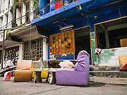 "07 OCTOBER 2012 - BANGKOK, THAILAND:   Furniture from a closed bar sits on the street in Washington Square in Bangkok. Washington Square was a notorious Bangkok ""entertainment district"" at the end of Soi 22 on Sukhumvit Road with several bars, massage parlors and restaurants that appealed primarily to older western male retirees, called ""sexpats"" by Bangkok residents. It was established during the Vietnam War when American servicemen on Rest and Recreation (R&R) leave from Vietnam visited Bangkok for its inexpensive nightlife and liquor. Its reputation was solidified after the war, when American military and intelligence agency retirees settled in Bangkok. Bars in Washington Square have been closing as their leases expire and the area was razed over the summer. The owners of the land are expected to redevelop it into a high rise condominium, office tower or hotel.   PHOTO BY JACK KURTZ"