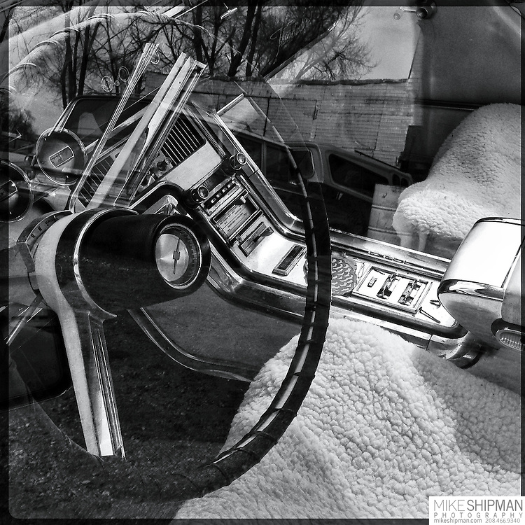 Front seat and steering wheel of a classic Ford Thunderbird
