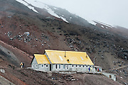 José Ribas hut (15,750 feet/4800 meters) is a climbers refuge on Cotopaxi, a stratovolcano in the Andes Mountains, about 75 kilometers (50 miles) south of Quito, Ecuador, South America. It is the second highest summit in Ecuador, reaching a height of 5,897 m (19,347 ft). Cotopaxi has an almost symmetrical cone that rises from a highland plain of about 3,800 metres (12,500 ft), with a width at its base of about 23 kilometers (14 mi). It has one of the few equatorial glaciers in the world, which starts at the height of 5,000 meters (16,400 feet). The mountain is clearly visible on the skyline from Quito. It is part of the chain of volcanoes around the Pacific plate known as the Pacific Ring of Fire.