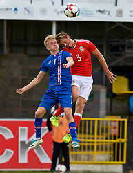 RHYL, WALES - Monday, September 4, 2017: Wales' Joe Lewis and Iceland's Atlu Hrafn Andrason during an Under-19 international friendly match between Wales and Iceland at Belle Vue. (Pic by Paul Greenwood/Propaganda)