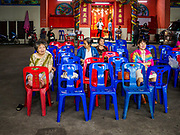 "12 JANUARY 2018 - BANGKOK, THAILAND: Spectators at a Chinese opera performance at the Chaomae Thapthim Shrine in the Dusit district of Bangkok. Many Chinese shrines and temples host Chinese operas during the Lunar New Year. Lunar New Year is 16 February this year and opera troupes are starting their holiday engagements at local Chinese temples and shrines. The new year will be the ""Year of the Dog."" Chinese New Year, also called Lunar New Year or Tet, is widely celebrated in Chinese communities around the world. Thailand has a large Chinese community and Lunar New Year is an important holiday.      PHOTO BY JACK KURTZ"