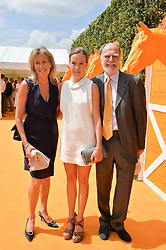 VISCOUNT & VISCOUNTESS COWDRAY with their daughter the HON.EMILY PEARSON at the Veuve Clicquot Gold Cup Final at Cowdray Park Polo Club, Midhurst, West Sussex on 20th July 2014.
