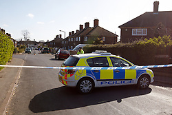 © Licensed to London News Pictures.  01/04/2012. OXFORD, UK. Police officers guard the scene of the fatal stabbing of an 29 year old man in St Martins Road, Rose Hill, Oxford. He died at the JR2 Hospital from a suspected stab wound to the chest. An 18 year old man has been arrested. Photo credit :  Cliff Hide/LNP