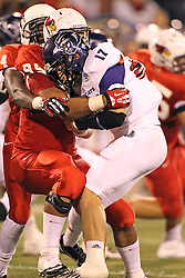 21 September 2013:  David Perkins and Bradon Prate team up for a sack on John David Baker during an NCAA football game between the Abilene Christian Wildcats and the Illinois State Redbirds at Hancock Stadium in Normal IL