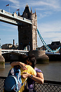 Scene of the River Thames, London. Running through the heart of the city. A coule embrace at Tower Bridge.