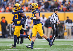 Nov 23, 2019; Morgantown, WV, USA; West Virginia Mountaineers safety Dante Bonamico (39) runs off the field during the fourth quarter against the Oklahoma State Cowboys at Mountaineer Field at Milan Puskar Stadium. Mandatory Credit: Ben Queen-USA TODAY Sports