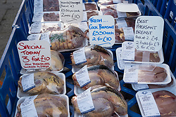 Fresh game on sale at weekend outdoor farmers's market held at foot of Edinburgh Castle in Edinburgh , Scotland, United Kingdom