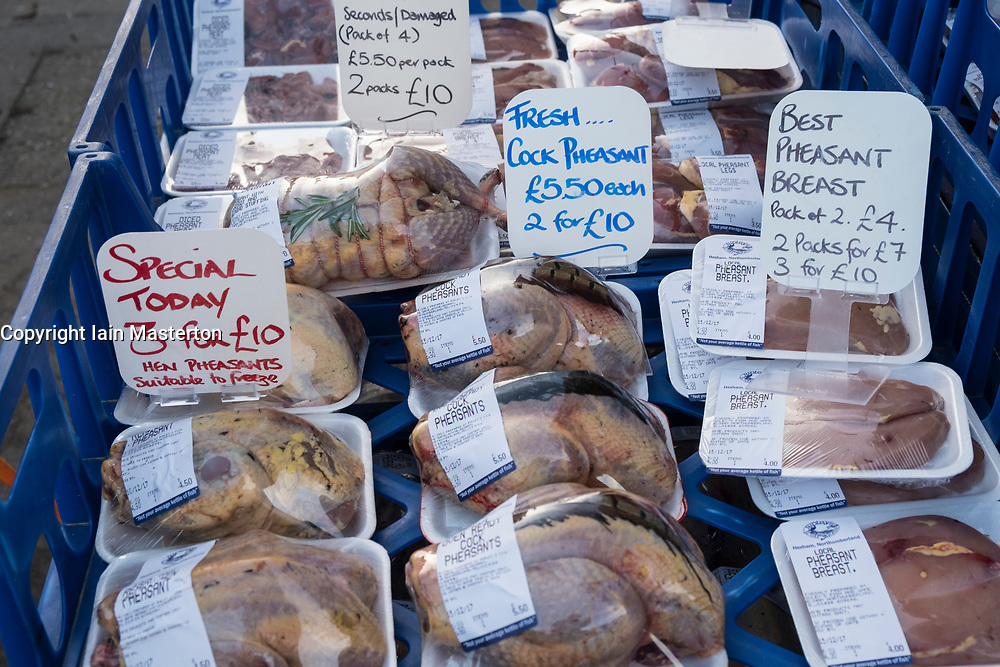 Fresh game on sale at weekend outdoor farmers's market held at foot of Edinburgh Castle in Edinburgh , Scotland, United Kingdom
