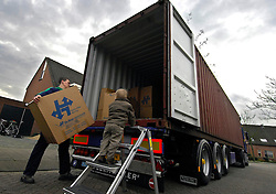 OUD-HEUSDEN, THE NETHERLANDS - FEB-23-2007 - Niek Diepeveen, 2, watches as movers from De Haan Removals fill a shipping container with his family's household belongings, for shipment to Japan, where Mr. Diepeveen will work for the Dutch multi-national company Wartsila Propulsion B.V.  (PHOTO / JOCK FISTICK)