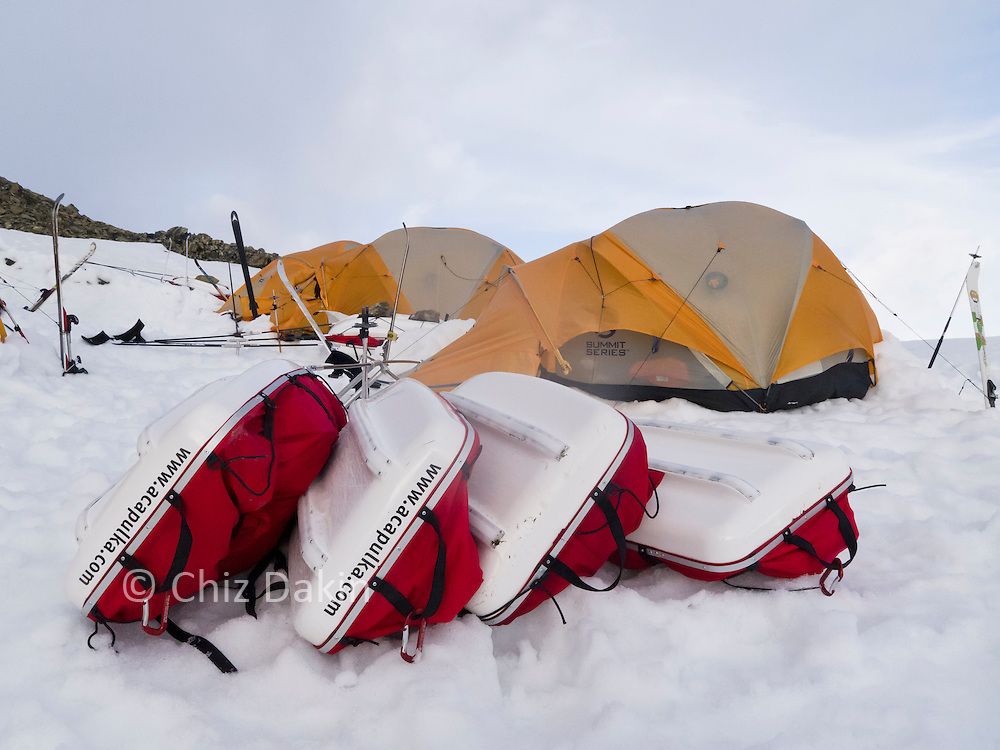 Expedition camp on Trident Col (Shackleton's Traverse, South Georgia) - pulkas in foreground, tents in background. Skis standing on end as tent poles.