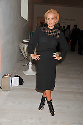 """DAVINIA TAYLOR at the launch of """"Photo-Me by Starck"""" – a photobooth exclusively designed by the world renowned artist and creator Philippe Starck held at The Saatchi Gallery, Duke Of York Square, Kings Road, London on 2nd November 2011."""