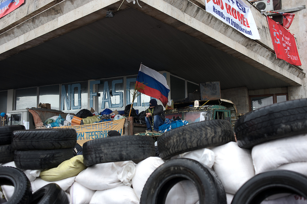 Pro-Russia activists take guard at Donbass Regional Government building in central Donetsk. Activists occupied the building over the past weekend and are now barricaded inside expecting a policial intervention as the Ukrainian government in Kiev gave a 48 hour deadline for the activists to abandon the building.