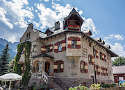 """The castle-like residence of Villa Wachtler was built in 1911 in Alpine Art Nouveau style, in Innichen/San Candido, in the valley of Alta Pusteria/Pustertal, in Trentino-Alto Adige/Südtirol (South Tyrol), Italy, Europe. Villa Wachtler is the residence of Michael Wachtler, who is founder of the town's Dolomythos Museum and is self-described as a """"discoverer, philosopher of nature, author, and film director."""" Innichen is a gateway to the Sesto Dolomites (Dolomiti di Sesto / Sexten / Sextner / Sextener Dolomiten) mountains, part of the Southern Limestone Alps. UNESCO honored the Dolomites as a natural World Heritage Site in 2009."""