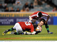18 June 2013; Andrew Smith, Brumbies, is tackled by Brad Barritt, left, and Christian Wade, British & Irish Lions. British & Irish Lions Tour 2013, Brumbies v British & Irish Lions, Canberra Stadium, Bruce, Canberra, Australia. Picture credit: Stephen McCarthy / SPORTSFILE