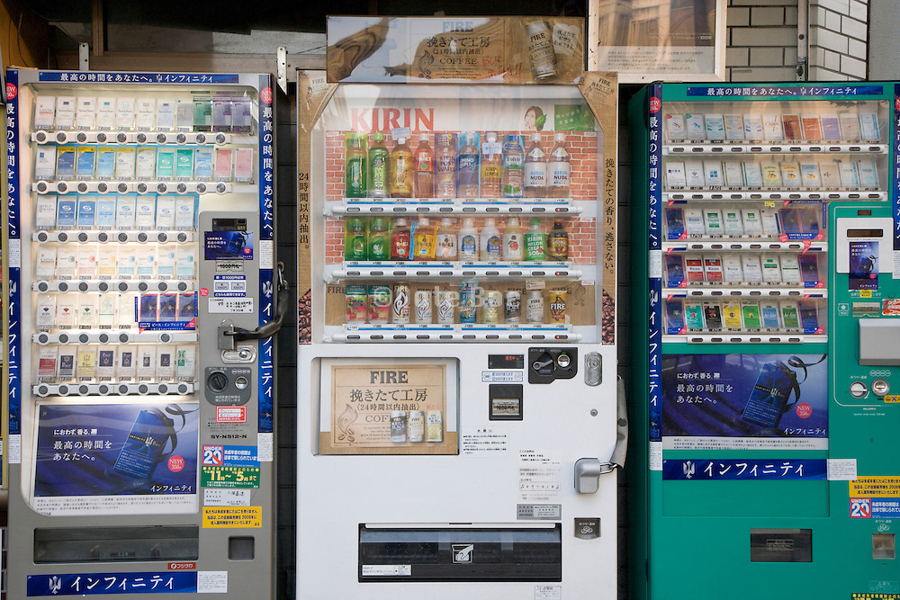 cigarettes and soda vending machines outside a small grocery store in Kyoto Japan