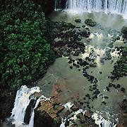 South America, Brazil, Argentina, Igwazu, Igwacu Falls thunder into the Igwacu River below.
