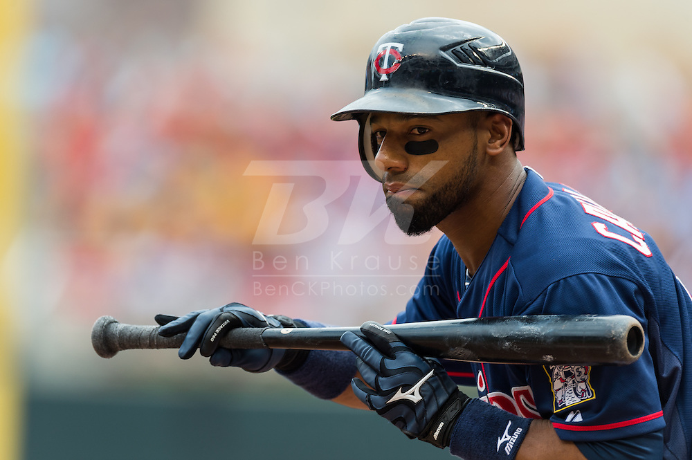 Alexi Casilla (12) of the Minnesota Twins pulls back his bat during a bunt attempt during a game against the Detroit Tigers on August 15, 2012 at Target Field in Minneapolis, Minnesota.  The Tigers defeated the Twins 5 to 1.  Photo: Ben Krause