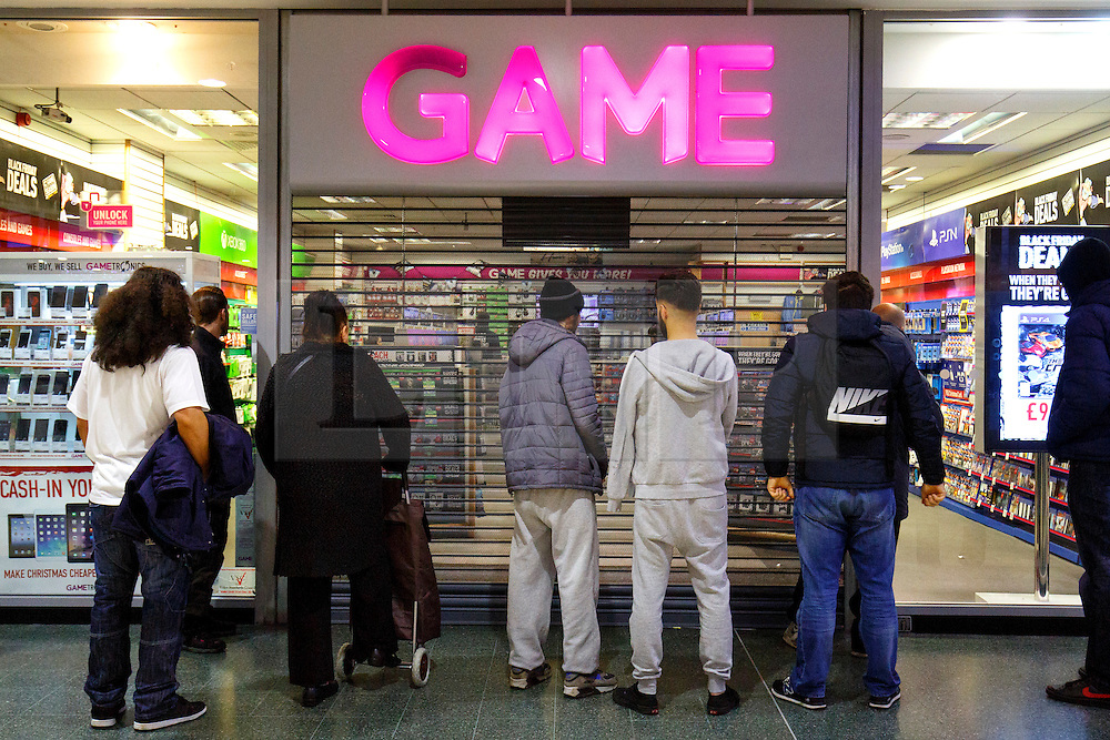 © Licensed to London News Pictures. 26/11/2015. London, UK. Black Friday shoppers queueing outside a Game store to buy reduced items at Wood Green Shopping Centre in north London on Friday, 27 November 2015. Photo credit: Tolga Akmen/LNP