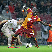 Galatasaray's Emmanuel Eboue (R) and CFR Cluj's Laszlo Sepsi during their UEFA Champions League Group H matchday 3 soccer match Galatasaray between CFR Cluj at the TT Arena Ali Sami Yen Spor Kompleksi in Istanbul, Turkey on Tuesday 23 October 2012. Photo by Aykut AKICI/TURKPIX