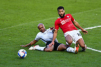 Football - 2020 / 2021 Sky Bet Championship - Swansea City vs Bristol City - Liberty Stadium<br /> <br /> Adrian Mariappa Bristol City challenged by André Ayew Swansea City <br /> <br /> <br /> COLORSPORT/WINSTON BYNORTH