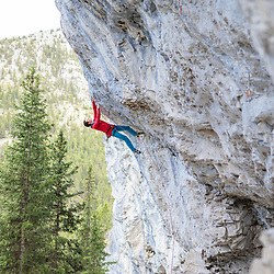 Adam Ondra warming up at Acephale in Canmore, Alberta